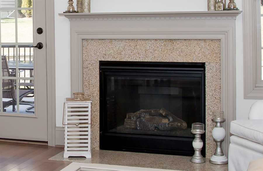 Real Estate Photography - 74 Centerville Rd, Wilmington, DE, 19808 - Gas fireplace in living room