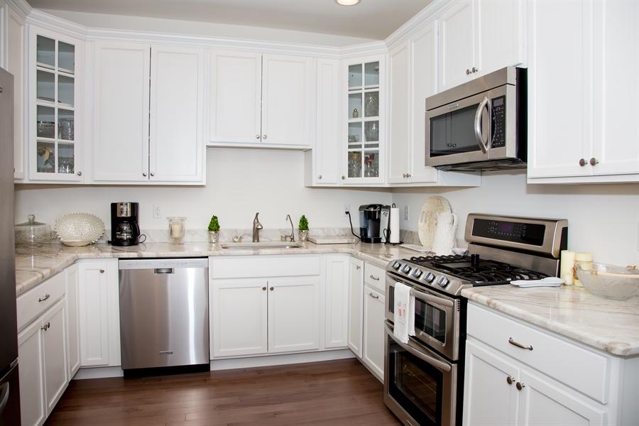 Real Estate Photography - 74 Centerville Rd, Wilmington, DE, 19808 - 11 X 12 upgraded kitchen, hardwood floors