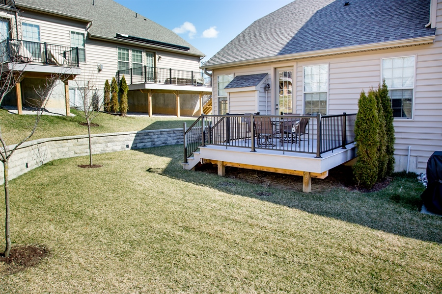 Real Estate Photography - 74 Centerville Rd, Wilmington, DE, 19808 - View of expanded deck and back yard