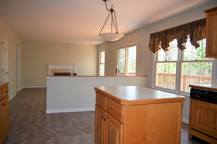 Real Estate Photography - 511 Summerbreeze Dr, Newark, DE, 19702 - Kitchen w half wall into Family Room