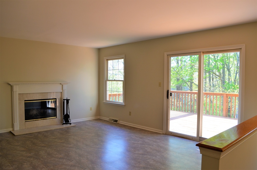 Real Estate Photography - 511 Summerbreeze Dr, Newark, DE, 19702 - Family Room w Fireplace and Slider to Deck