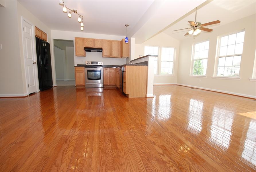 Real Estate Photography - 164 Harvest Grove Trl, Dover, DE, 19901 - Beautiful refinished hardwood floors