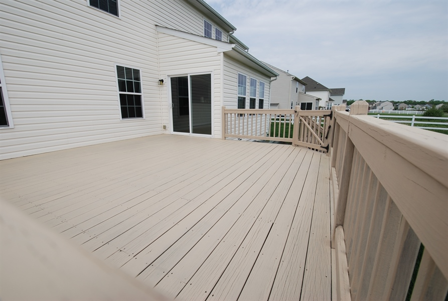 Real Estate Photography - 164 Harvest Grove Trl, Dover, DE, 19901 - recently stained deck