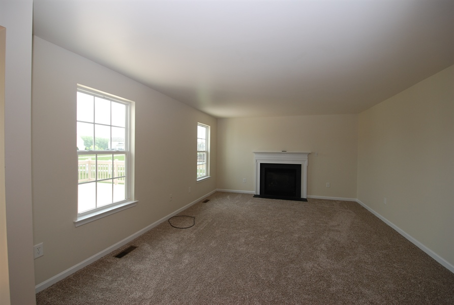 Real Estate Photography - 164 Harvest Grove Trl, Dover, DE, 19901 - Family room with cozy fireplace