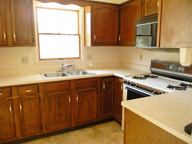 Real Estate Photography - 695 Ragan Rd, Conowingo, MD, 21918 - KITCHEN, SEE PASTURE FROM WINDOW