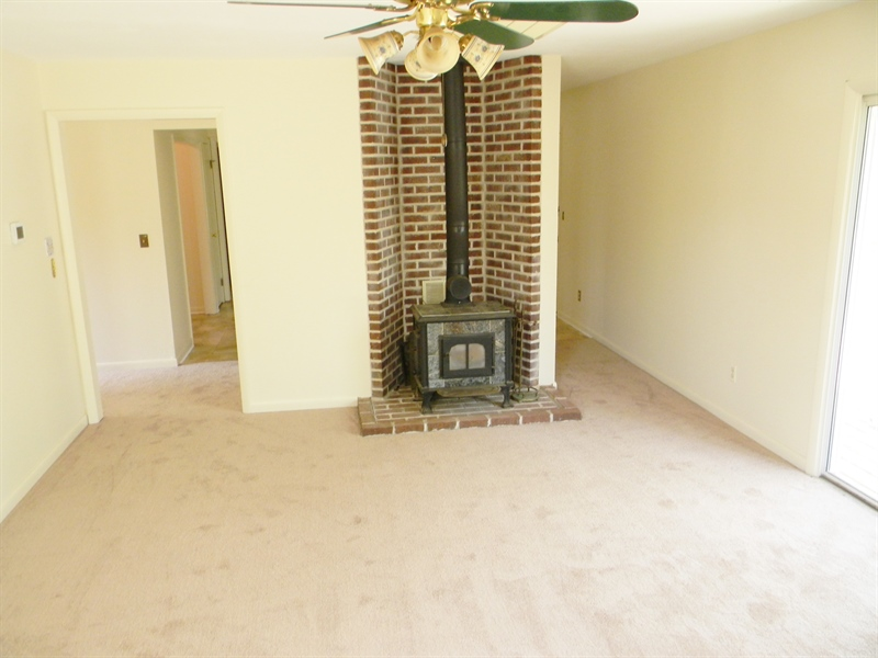 Real Estate Photography - 695 Ragan Rd, Conowingo, MD, 21918 - LIVING RM. WITH WOOD STOVE