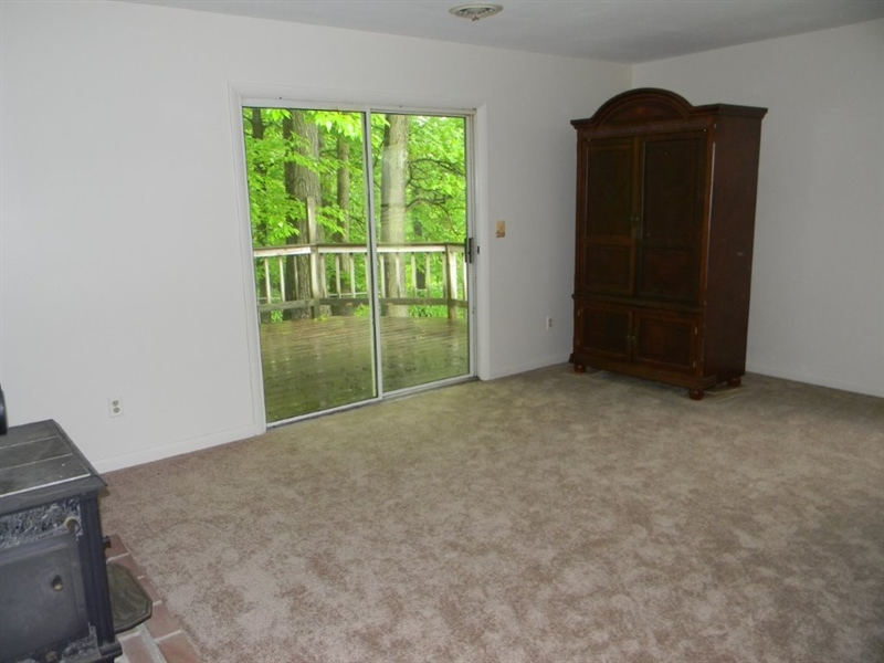 Real Estate Photography - 695 Ragan Rd, Conowingo, MD, 21918 - LIVING RM. SLIDERS TO DECK