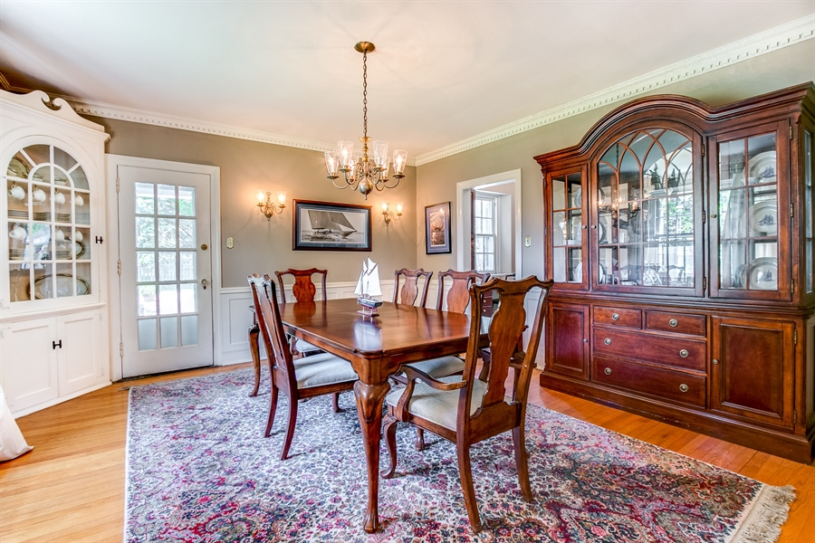 Real Estate Photography - 615 Old Wilmington Rd, Hockessin, DE, 19707 - Formal Dining Room with French door to Pool Area