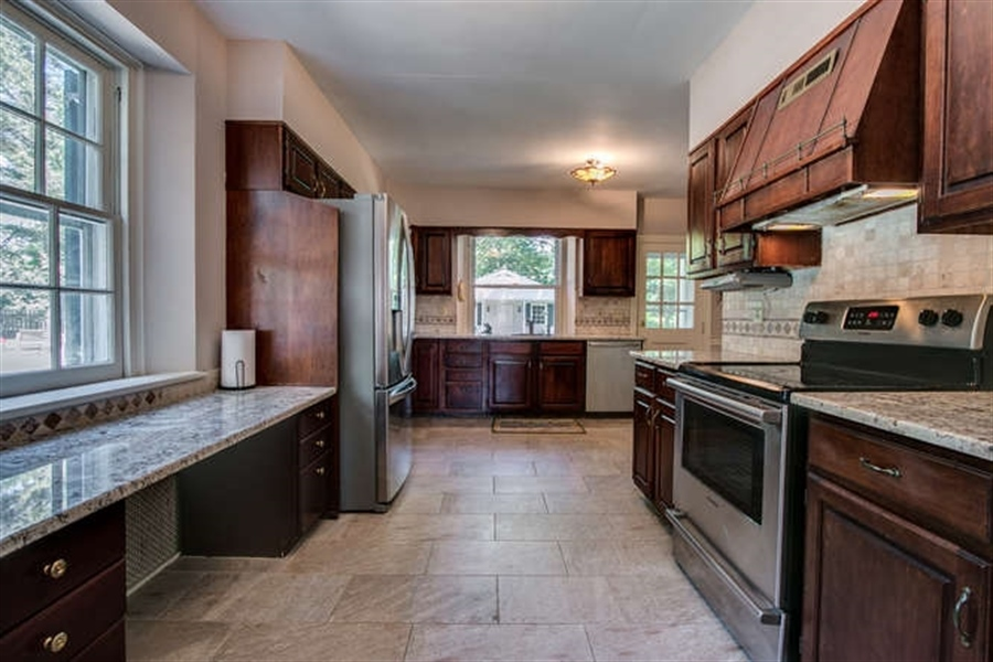 Real Estate Photography - 615 Old Wilmington Rd, Hockessin, DE, 19707 - Kitchen with Stainless Steel Appliances