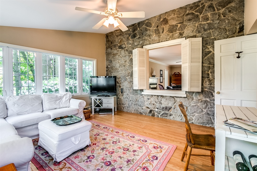Real Estate Photography - 615 Old Wilmington Rd, Hockessin, DE, 19707 - Family Room with Stone Wall
