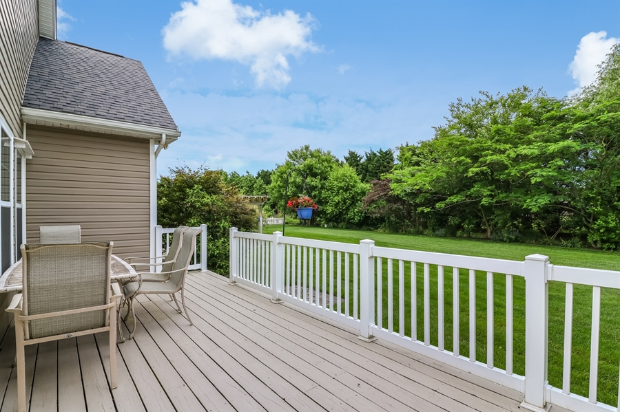 Real Estate Photography - 13 Beacon Cir, Millsboro, DE, 19966 - Large deck overlooking beautiful back yard