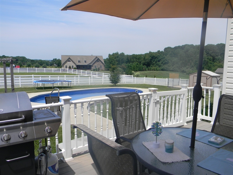 Real Estate Photography - 85 Rolling Green Ln, Elkton, MD, 21921 - Deck Overlooking In-ground Pool