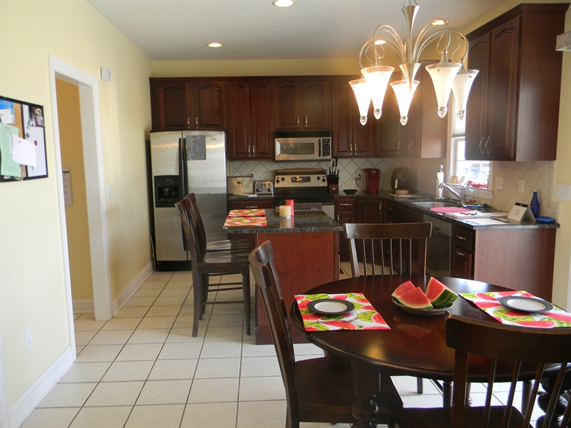 Real Estate Photography - 85 Rolling Green Ln, Elkton, MD, 21921 - Eat-in Kitchen w/ Slider to Deck & Pool