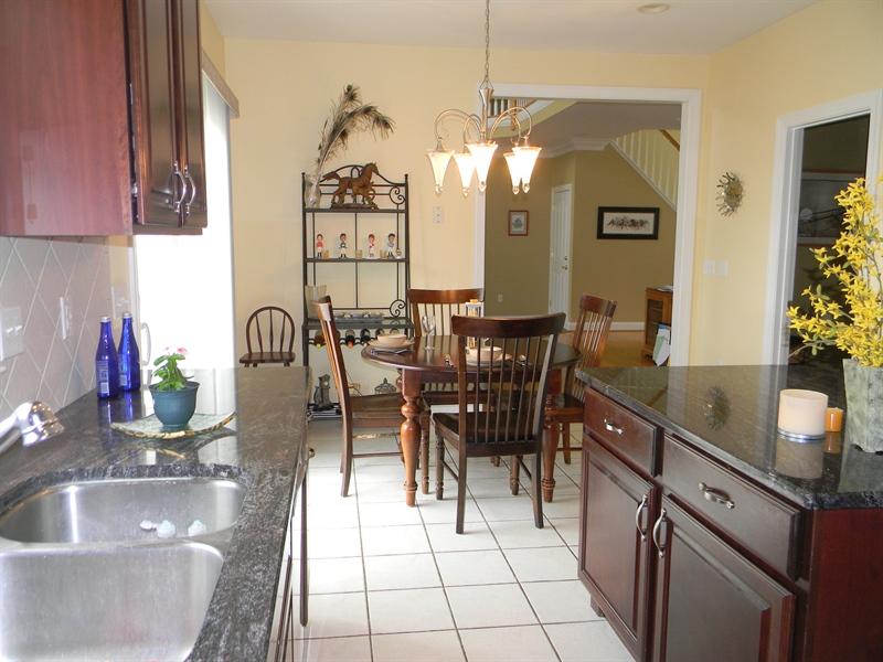Real Estate Photography - 85 Rolling Green Ln, Elkton, MD, 21921 - Cherry Cabinets, Granite, Ceramic Tile Floor