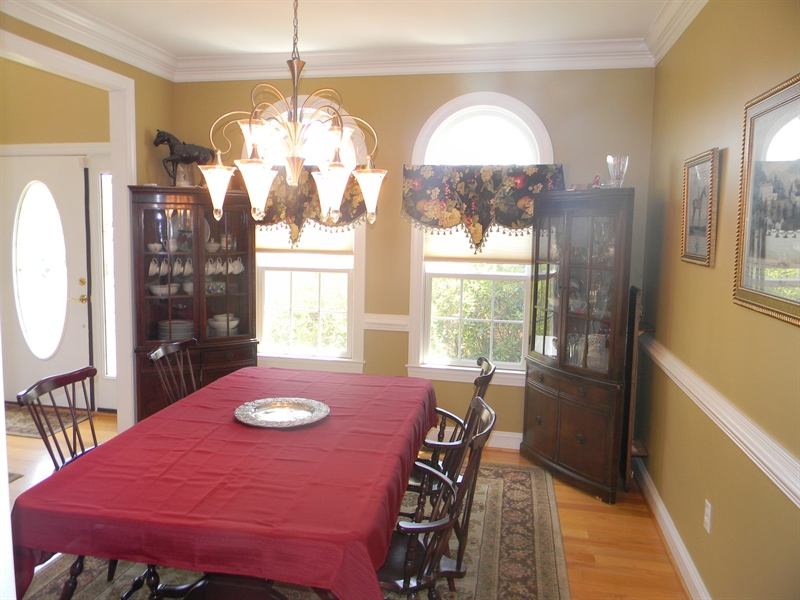 Real Estate Photography - 85 Rolling Green Ln, Elkton, MD, 21921 - Dining Room w/ Crown Molding & Chair Rail