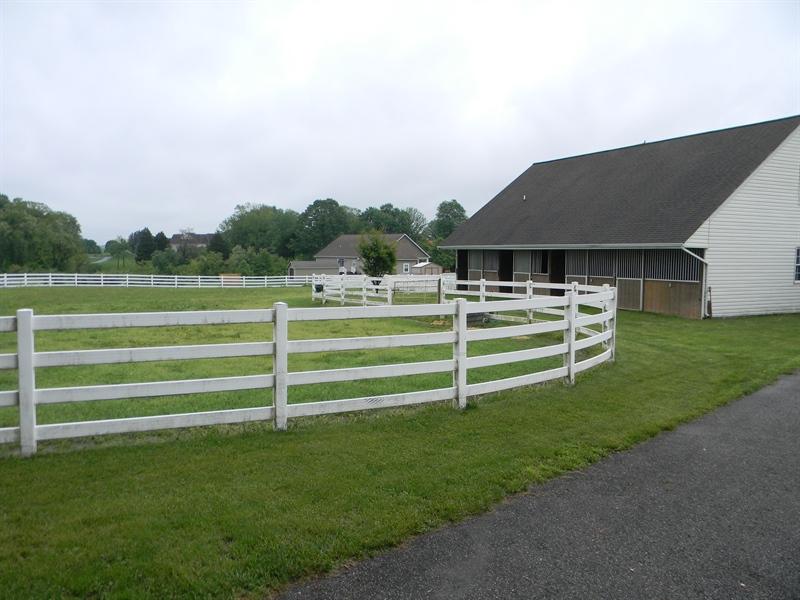 Real Estate Photography - 85 Rolling Green Ln, Elkton, MD, 21921 - 4 Rail Vinyl Fenced Paddock & Stalls