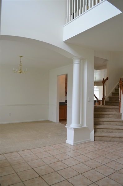 Real Estate Photography - 15 Bay Blvd, Newark, DE, 19702 - 2-Story Foyer Flanked by Dining Room & Living Room