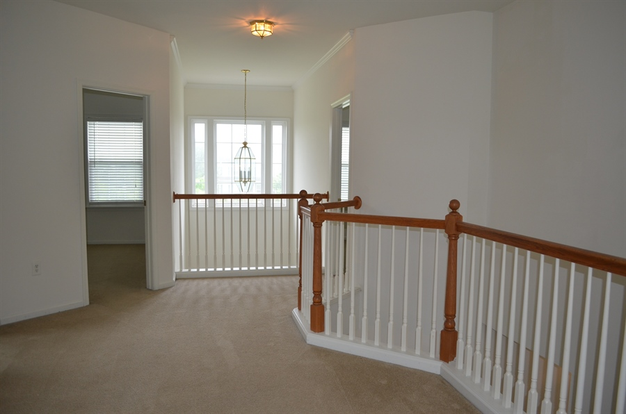 Real Estate Photography - 15 Bay Blvd, Newark, DE, 19702 - Hallway Leading to more Bedrooms