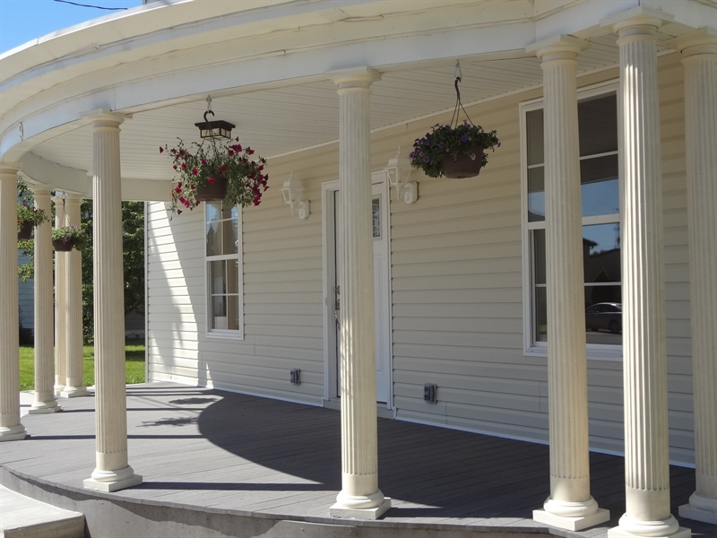 Real Estate Photography - 9 N Main Street, Magnolia, DE, 19962 - Inviting classical porch with fluted columns