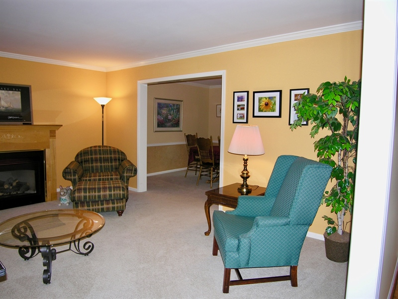 Real Estate Photography - 135 Belmont Dr, Wilmington, DE, 19808 - Living room open to Dining Room