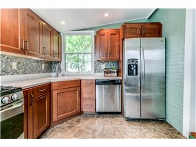 Real Estate Photography - 1524 Clinton St, Wilmington, DE, 19806 - Kitchen with Stainless Steel Appliances