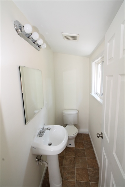 Real Estate Photography - 218 W 17th St, Wilmington, DE, 19802 - 1rst floor powder room