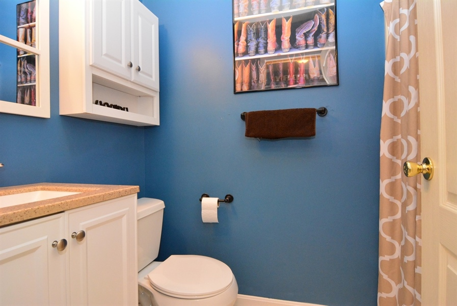 Real Estate Photography - 2 Whispering Woods Dr, Georgetown, DE, 19947 - 1st Floor Full Bath with Shower