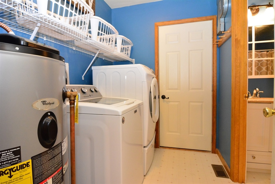 Real Estate Photography - 2 Whispering Woods Dr, Georgetown, DE, 19947 - 1st Floor Laundry Room off Garage