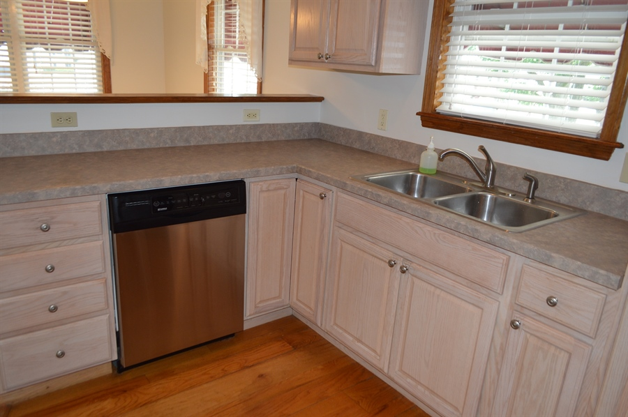 Real Estate Photography - 108 Rolling Dr, Newark, DE, 19713 - Kitchen updated, large pantry in mudroom too