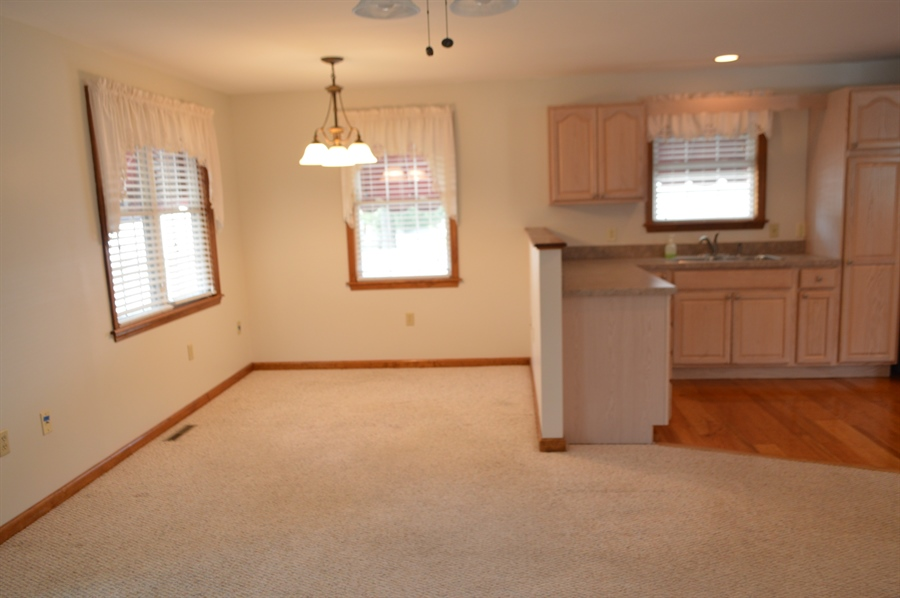 Real Estate Photography - 108 Rolling Dr, Newark, DE, 19713 - Table space adjacent to Kitchen