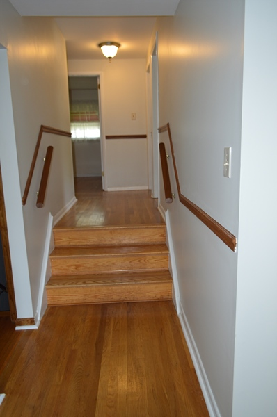 Real Estate Photography - 108 Rolling Dr, Newark, DE, 19713 - Up to the bedroom level, all beautiful hardwoods