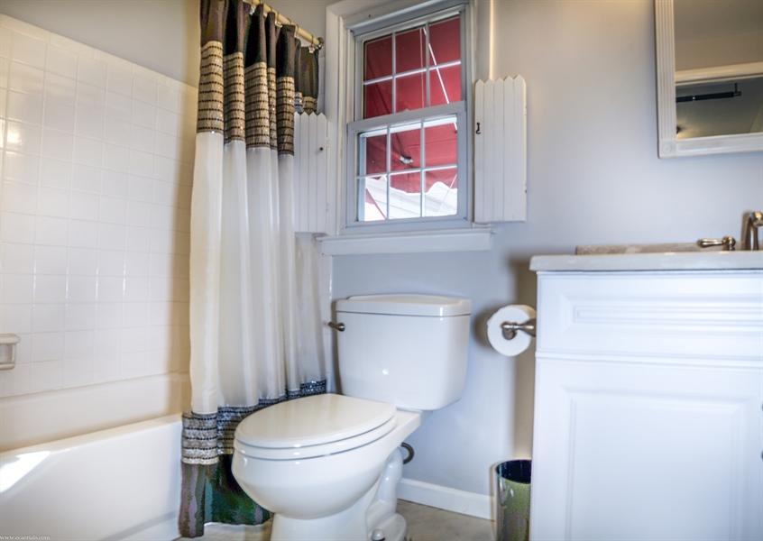 Real Estate Photography - 108 Rolling Dr, Newark, DE, 19713 - Bath - upgraded vanity & tile surround & floor