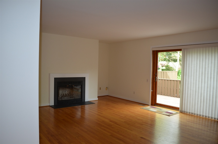 Real Estate Photography - 9 Steeplechase Rd, Wilmington, DE, 19808 - Living Room w Fireplace and New Slider to Deck