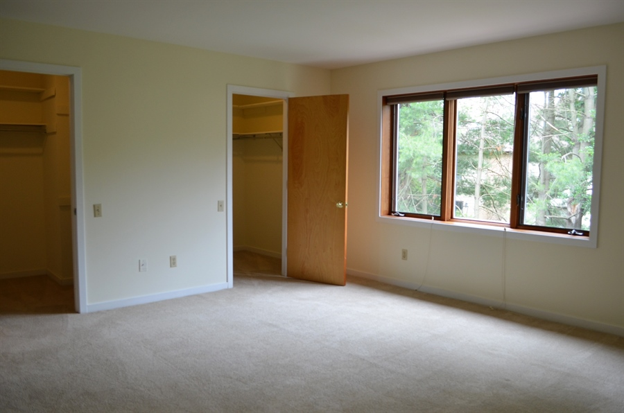 Real Estate Photography - 9 Steeplechase Rd, Wilmington, DE, 19808 - Master Bedroom w Double Walk-In closets