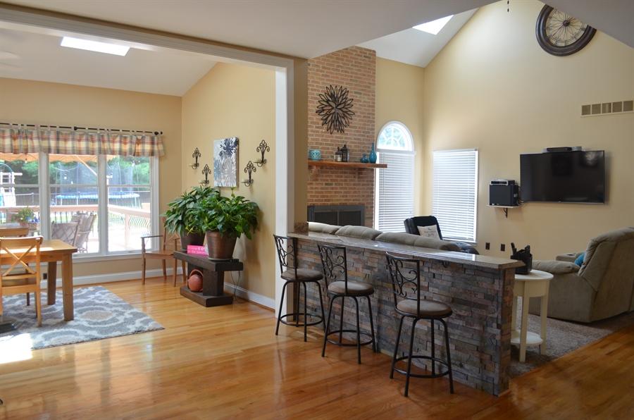 Real Estate Photography - 9 Winterbridge Ct, Newark, DE, 19711 - Breakfast Bar open to Sunroom and Great Room
