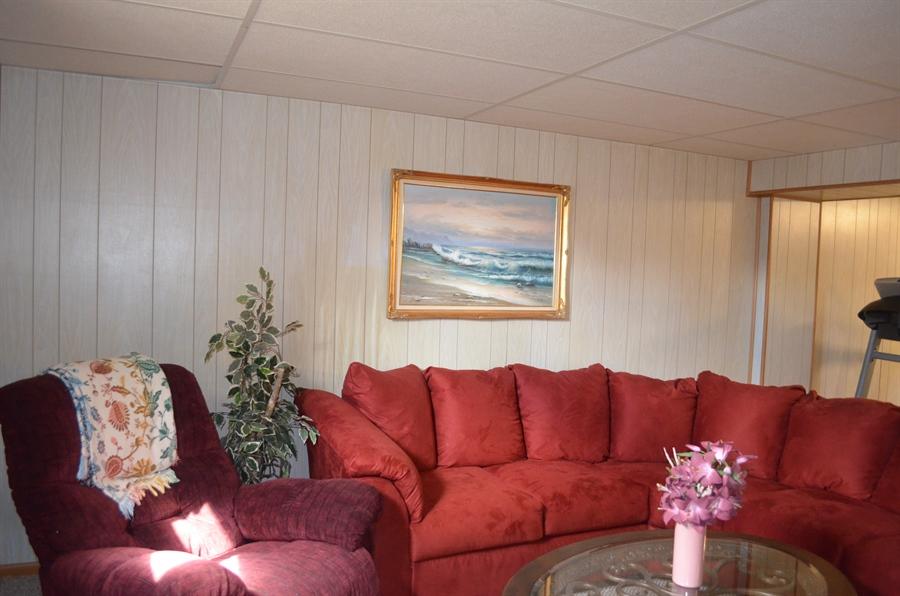 Real Estate Photography - 8 Newside Ct, Newark, DE, 19711 - Lower level family room
