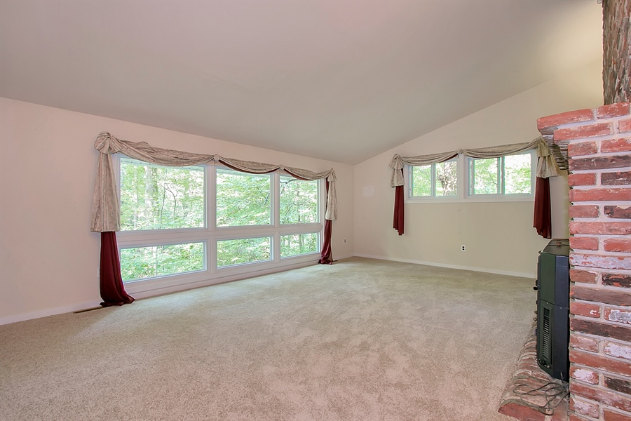 Real Estate Photography - 40 Indian Field Rd, Wilmington, DE, 19810 - Great Room with Vaulted Ceiling & Fireplace