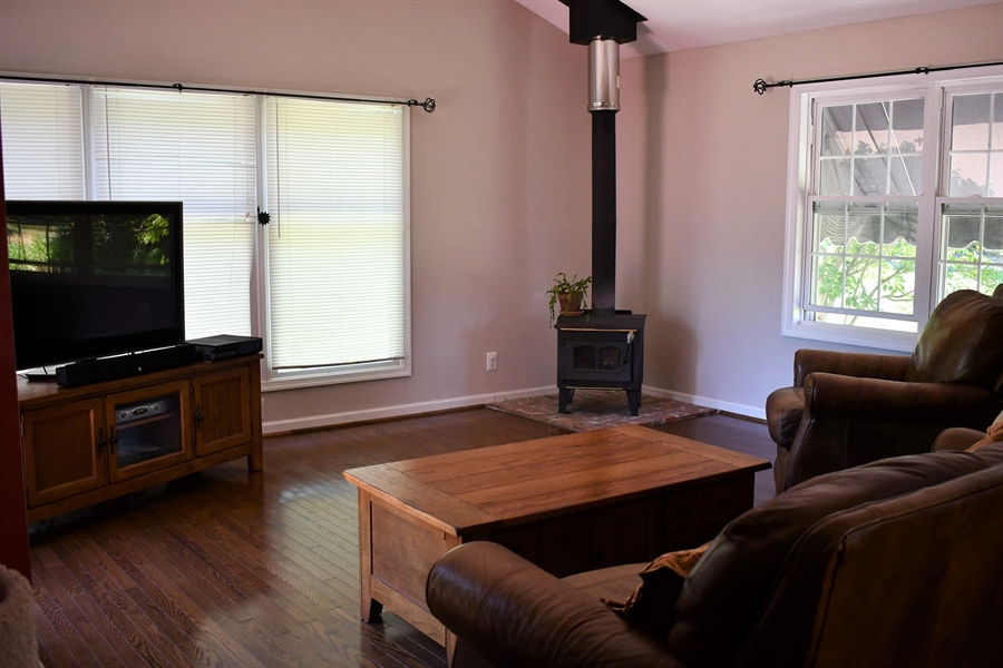 Real Estate Photography - 28 Morning Glen Ln, Newark, DE, 19711 - Great room with wood burning fireplace