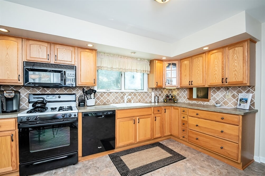 Real Estate Photography - 2319 Empire Dr, Wilmington, DE, 19810 - Kitchen w/ plenty of cabinets & recessed lighting