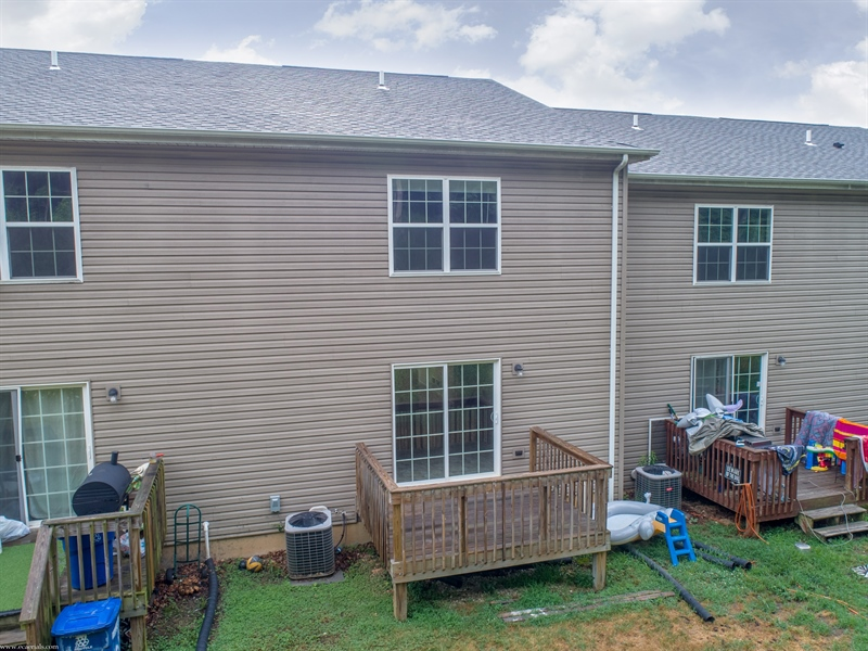 Real Estate Photography - 137 Ben Blvd, Elkton, DE, 21921 - Rear view with deck off kitchen, backs to woods