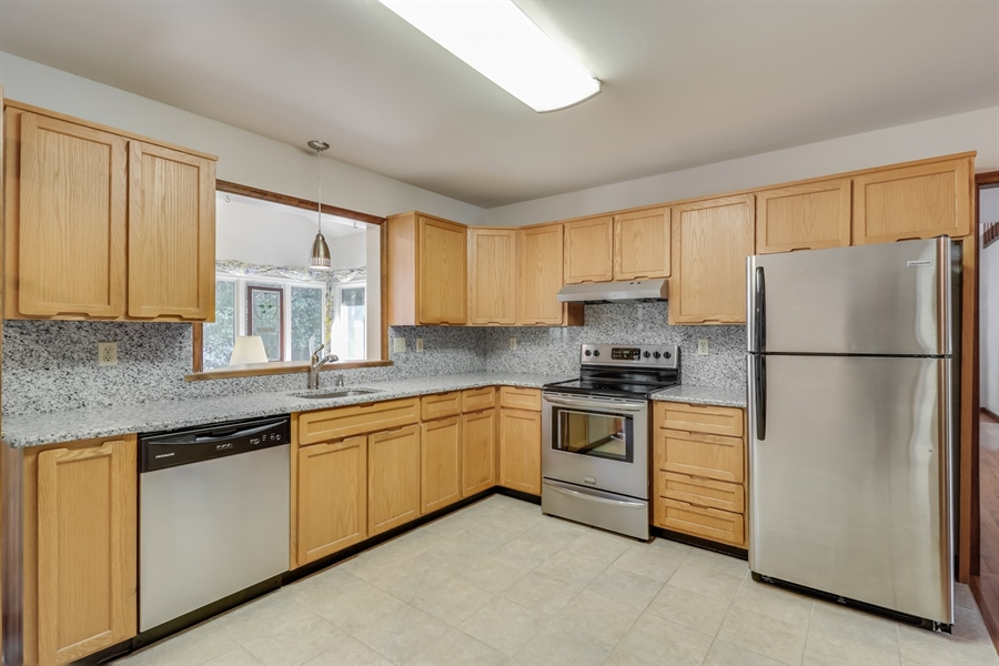 Real Estate Photography - 235 Pine Valley Rd, Dover, DE, 19904 - Kitchen with granite counters and back splash.