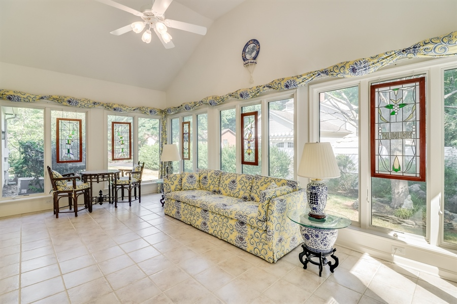 Real Estate Photography - 235 Pine Valley Rd, Dover, DE, 19904 - Bright and cheery sunroom w vaulted ceiling