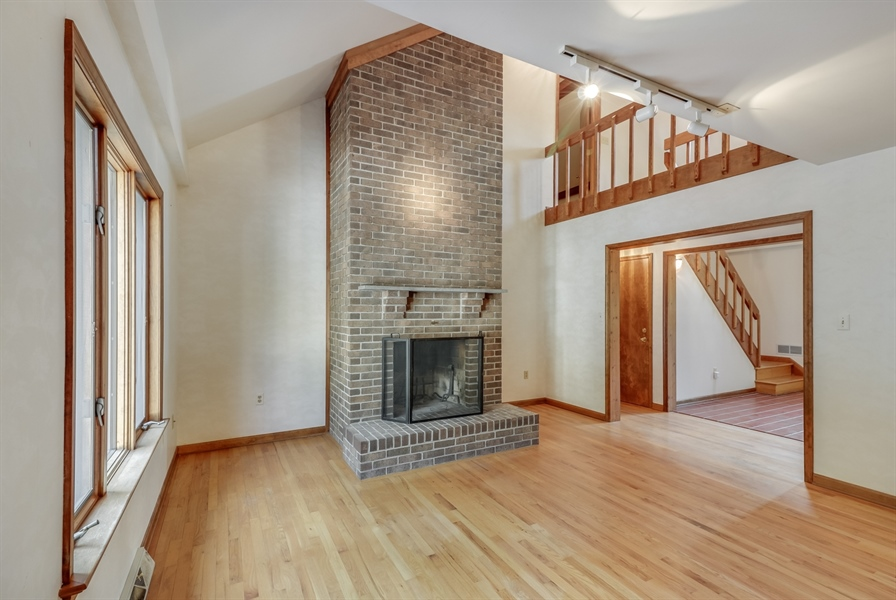 Real Estate Photography - 235 Pine Valley Rd, Dover, DE, 19904 - Living room with floor to ceiling fireplace