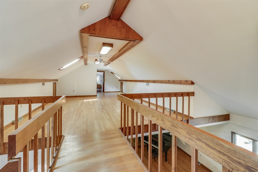 """Real Estate Photography - 235 Pine Valley Rd, Dover, DE, 19904 - Upstairs """"catwalk"""" overlooking the living room"""