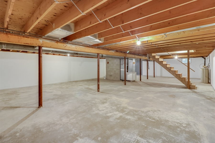 Real Estate Photography - 235 Pine Valley Rd, Dover, DE, 19904 - Full basement with walk out.  Ready to be finished