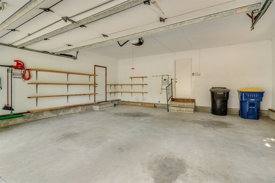 Real Estate Photography - 235 Pine Valley Rd, Dover, DE, 19904 - 2 car garage with built in storage shelves