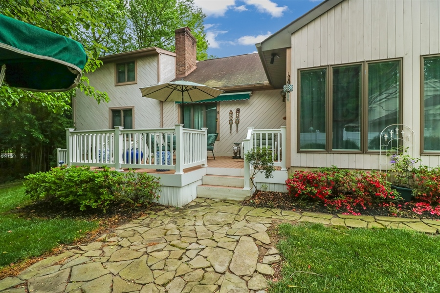 Real Estate Photography - 235 Pine Valley Rd, Dover, DE, 19904 - Back maintenance free deck with retractable awning