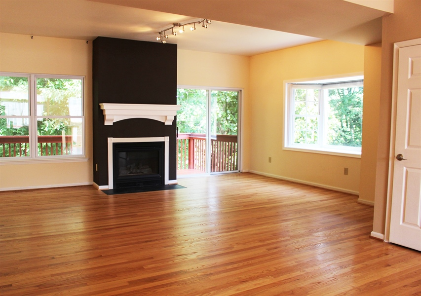 Real Estate Photography - 203 Thomas Ln S, Newark, DE, 19711 - Great room with newly refinished hardwoods
