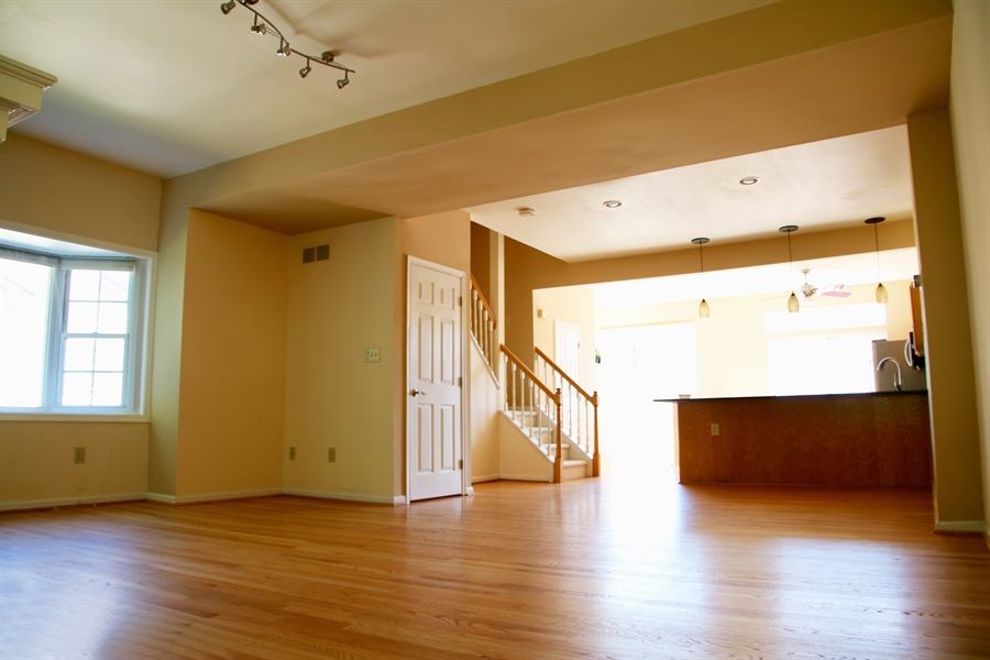 Real Estate Photography - 203 Thomas Ln S, Newark, DE, 19711 - Great room w/ newly finished hardwoods.