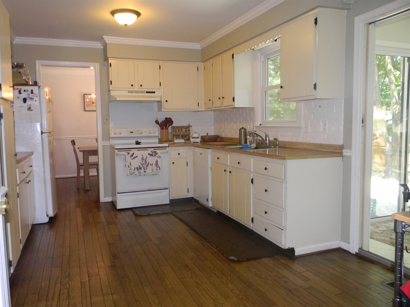 Real Estate Photography - 112 Kirkcaldy Dr, Elkton, MD, 21921 - Hardwood flooring in kitchen